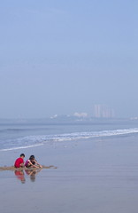img_1767flx (kapilmerc) Tags: childrenplaying beach sunlight sea waves blue red d white reflections