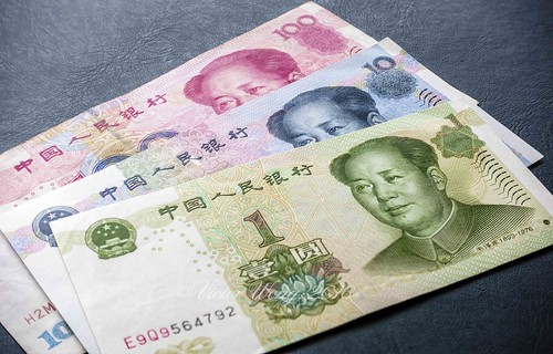 China's one hundred, ten and one dollar bill denominations