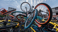 Bike stock pile (Philipp Salveter) Tags: china shanghai bike bicycle color mobike ofo environment city shared business economy rental wheel