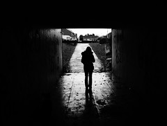 Rain, Rain, Go Away (JamieHaugh) Tags: clevedon northsomerset england uk sony a6000 outdoors blackwhite blackandwhite monochrome bw subway silhouette underpass shadows rain figure woman person lady gb greatbritain