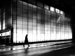 l'homme au parapluie (René Mollet) Tags: umbrella man morning rain nightshot lonely street streetphotography shadow silhouette streetart streetphotographiebw blackandwhite bw basel backlight candite renémollet