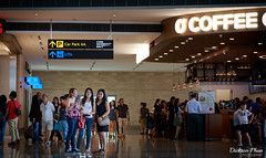 The weekend visitors (gunman47) Tags: 2017 4 airport asia changi east international november sg singapore south terminal group people photo photography street tourist visitor visitors weekend sign ceiling