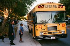 Boarding the School Bus (beltz6) Tags: zm people cbiogont2835 bus schoolbus shortbus child children dog biogonc3528zm zeiss leica m7 leicam7 bluebird
