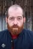 Robert (Levi Smith Photography) Tags: beard redhead ginger man handsome jacket wall fence wood smirk contemplative portrait headshot