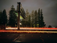 Frontage Photon Affair (RZ68) Tags: frontagerd freeway highway traffic red white sign big cars trees redwood night lg lgg6 g6 cameraphone longexposure wet rain clouds storm