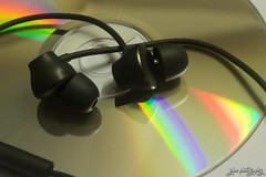 Shades of Music (smzoha) Tags: macromonday stonerhymingzone earphones disc music reflection lights rainbow colors colorful vibrant abstract macro closeup 7dwf
