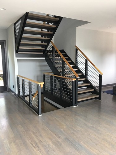 Modern staircases build by Andronic's Construction co inc in Charlotte NC.