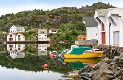 Calm Waters (Ranveig Marie Photography) Tags: rorbuer lyklingsjøen lykling bømlo reflection seascape norway harbor boats houses homes quay woods norge boathouses trees hordaland island sunnhordland norwegen norsk natur norwegian skandinavisk nordisk sea ocean water landscape shore coast boat kai boathouse pier brygge naust sjøhus wood wooden nøst bootshaus nausttuft båthus jetty silence peace tranquility serenity images pictures photos ranveigmarienesse ranveignesse båter sjø pics photographs paysage bilder sigmaart sigmaart1835mm sigma nikon nikond5200 visitsunnhordland photography still stillhet