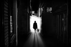 Alleyway angel (Daz Smith) Tags: dazsmith fujixt20 fuji xt20 andwhite bath city streetphotography people candid portrait citylife thecity urban streets uk monochrome blancoynegro blackandwhite mono silhouette woman corridoor alley light rays bathed
