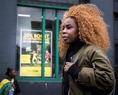 Carnival Candid II (XBeauPhoto) Tags: hackneycarnival london londonstreet afrocarribean candid candidportrait elderlywoman ethnic fashion furryhat hackney hair hairstyle streetphoto streetphotography