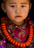 Tibetan child girl with a huge necklace, Tongren County, Rebkong, China (Eric Lafforgue) Tags: 45years adorned amdo asia asian asianethnicity china china17125 colourimage ethnic ethnicity frontview headshot huangnan jewel jewellery jewlery lookingatcamera necklace onechildonly onegirlonly onepersononly ornament ornamental ornate ornated people portrait posing qinghai qinghaiprovince rebkong tibet tibetan tibetanautonomousprefecture tongren traditionalclothing travel vertical worldtravel tongrencounty chn