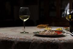 Squid dinner (LuxTDG) Tags: bella cena calamari pretty calice vino bianco white wine glass madeofglass limoni lemons pane bread design view luce luminosa bright light digital crepuscolo dusk colori colour ombre shadows ghiaccio ice