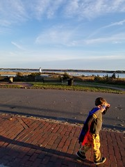 On the lookout (quinn.anya) Tags: sam preschooler superman superhero lighthouse sunset edgartown marthasvineyard lookout