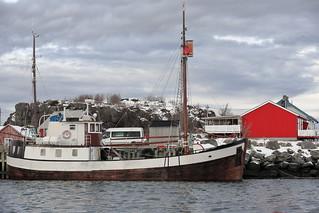 Old wooden fishing boat moored in the port-Laukvik-Vagan kommune-Austvagoya-Lofoten-Norway. 0630