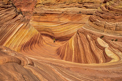 The Rainbow of Rocks, The Wave (Guy Lacroix) Tags: thewave arizona hiking desert southwest usa sandston coloradoplateau coyotebuttes pariacanyonvermilioncliffs wildernessarea restrictedarea bureauoflandmanagement grandstaircaseescalantenationalmonument hikers geology jurassicage navajosandstone crossbedded eoliansandstone dinosaurtracks fossilburrows northcoyotebuttes vermilioncliffs pariacanyon wilderness rock roche explore exploring nature eolian sandstonecrossbedded guylacroixflickr wife