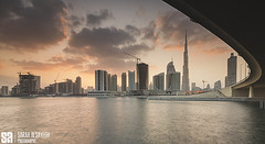 UAE - Dubai - Sunset With Dubai Skyline Under The Bridge (Sarah Al-Sayegh Photography | www.salsayegh.com) Tags: unitedarabemirates uae dubai canoneos5dmarkiii canon cityscape wwwsalsayeghcom sarahhalsayeghphotography