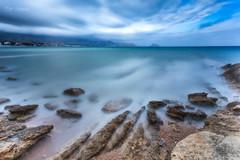 Rocky Seascape (Normann Photography) Tags: lalfàsdelpi leefilters spain thebigstopper thebluealbirreef blue longexposure outddor reef rocks sea shore comunidadvalenciana spania es