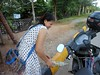 I purchase petroleum from this businesswoman, and sometimes watermelons. (rodeochiangmai) Tags: motorbike cambodia petroleum transportation polkadot