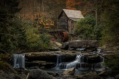 Glade Creek Grist Mill (Justashotinthedark.com) Tags: mill autumn historic water watermill fall flowing red wv trees creek parkway waterfall scenic westvirginia yellow wheel wood country waterwheel landscape gladecreekgristmill virginia old downstream stream west vintage rural river sunrise down landmark glade babcockstatepark colorful scenery beautiful travel forest cascade httpjustashotinthedarkcom colors park state grist rustic ridge