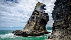 Nun Rock (Kathrin & Stefan) Tags: nunrock tasmansea cloud nature ocean outdoor rock sky wave aucklandwaitakere northisland newzealand