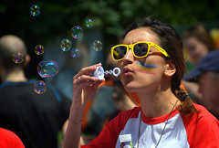 Bubbles (Owen J Fitzpatrick) Tags: ojf people photography nikon fitzpatrick owen j joe pretty pavement chasing d3100 ireland editorial use only ojfitzpatrick eire dublin republic city tamron beautiful beauty attractive lady pride 2017 june 24 24th 24062017 parade march festival lgbt lgbtq stephens green south assembly premarch rainbow diversity spectrum portrait candid candidphotography candidphoto unposed natural woman female blow blowing bubbles yellow shades sunglasses face bubble red brunette
