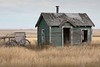 Where Are The Pigs? (Edmonton Ken) Tags: animal farm old peeling paint missing shingles abandoned wheels door window empty fence prairie western chimney grass fall autumn weeds decrepit siding building shed teal white brown sky play house