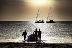 Time to catch the tide - Explore 28.11.27 thanks! (Jo Evans1 - off and on for a while) Tags: papagayo beach lanzarote men launching dinghy yachts rich lifestyle sunset