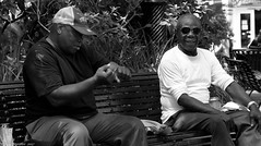 Beer and Baseball (Neil. Moralee) Tags: neilmoralee usa2017neilmoralee man men talk talking baseball beer drink brown paper bag street candid new orleans sit sitting cap hat face portrait couple pair swing glasses sunshine neil moralee nikon d7200 black white mono monochrome bw bandw blackandwhite usa baby cakes old mature park bench