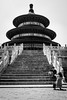 Under trial (Go-tea 郭天) Tags: beijing temple of heaven tourist touristic ancient pavillon wood wodden construction history historical historic family together photography posing trial young kid girl mother father dad mom cute united little stairs steps seated seat shoot shooting difficulty difficult sun sunny sunglasses fun fan bag love candid street urban city outside outdoor people bw bnw black white blackwhite blackandwhite monochrome naturallight natural light asia asian china chinese canon eos 100d 24mm prime