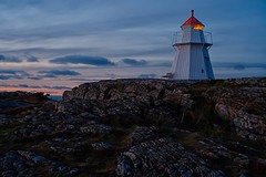 A warning, to be cautious of the waves and more (keith_fannon) Tags: abigfave lighthouse bualighthouse varberg väröbacka sweden sverige sea water rock cliff stone coast sunset dusk evening light cöoud sky cloud bench darkness halland
