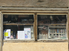 Collection in the window (2 of 2) (jimsawthat) Tags: junk collection window downtown abandoned decay smalltown shoshoni wyoming