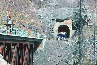 BCOL RDC BC-12 at mile 49.6 exiting a short 800 foot tunnel on Tumbler Ridge Branch. The bridge spans Lost Creek.