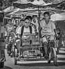 Umbrella Pedicabs of Davao City (FotoGrazio) Tags: asian davaocity documentaryphotography filipino mindanao pacificislanders philippines pinoy republicofthephilippines streetphotography waynegrazio waynesgrazio worldphotographer bicycle blackandwhite composition contrast driver fotograzio passenger passengers pedicab pedicabs people socialdocumentary streetscene taxi transport transportation travelphotography