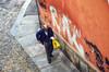 Controllando la lista della spesa (encantadissima) Tags: uomo torino piemonte streetphotography solitudine angoli graffiti