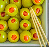 Stuffed (grbush) Tags: macromondays macro stick cocktailstick olives stuffedolives food foodphotography closeup green red bowl sonya7 tamronaf90f28disp hmm