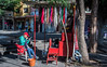 2017 - Mexico - Guadalajara - Street Vendor (Ted's photos - For Me & You) Tags: 2017 cropped guadalajara mexico nikon nikond750 nikonfx tedmcgrath tedsphotos tedsphotosmexico vignetting guadalajaramexico guadalajarajalisco chair onebottle ballcap streetscene shadow shadows pail bucket denim denimjeans canopy people peopleandpaths red redrule