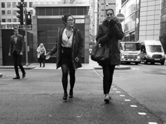 Wednesday (Darryl Scot-Walker) Tags: road people pedestrians citylife urban city london docklands corporate candid covertlondon covert street streetphotography bw monochrome blackandwhite woman man crossing pedestriancrossing traffic