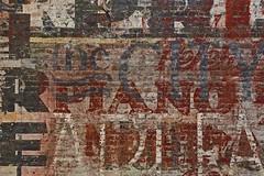 ghost wall 1 (remiklitsch) Tags: ghostsign wall bricks red black white piano city art fineart tires letters nikon urban santamonica california hostel remiklitsch