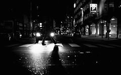 these boots are made for walking (ThorstenKoch) Tags: street streetphotography stadt strasse schatten shadow silhouette schwarzweiss monochrome man boots licht lights light night nacht fuji fujifilm thorstenkoch city candit car spotlights parking düsseldorf duesseldorf dark
