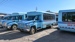 Takin rides in sky blue buses of a rural county's transit agency, where the buses are Chevrolet Kodiak C5500s from pre-2009. (Tim Kiser) Tags: 2016 20160807 august brushstreet c5500 capitalregion chevrolet chevroletkodiak chevroletkodiakc5500 clintoncounty clintoncountymichigan clintoncountytransitagency clintontransit img6000 lansingmetropolitanarea michigan saintjohns saintjohnsmichigan stjohns stjohnsmichigan areacode989 buses centralmichigan countytransitagency crumblingparkinglot demandresponse demandresponsetransit dialaride downtown downtownsaintjohns downtownstjohns electriclines gravel lightblueminibuses midmichigan minibuses overheadelectriclines overheadpowerlines paratransit phonenumber powerlines publictransit publictransitagency ruraltransit ruraltransitsystem skyblue skyblueminibuses sunny telephonenumber transitagency
