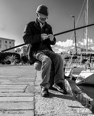the fisherman (alessandrochiolo) Tags: sicilia street siciliabedda sicily streetphoto sea streetphotografy biancoenero bw bn blackandwhite strada fujix30 fuji fujifilm
