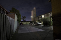 The Promised Land (Ranga 1) Tags: australia australian australianlandscape victoria newport urban urbanlandscape flats apartments charlestonapartments charlestonflats nocturnal night nightphotography nightexposure still stillness cars parking longexposure melbourneroad cinematic silos canon industrial industriallandscape industry canoneos5dmarkiii ef1740mmf4lusm davidyoung suburbs westernsuburbs explore