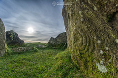 Life imitating art at Loughcrew (mythicalireland) Tags: megalithic rock art engraving carving stone age neolithic cairn loughcrew meath sun sunshine halo circle clouds weather phenomenon