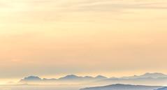 Pastel evening (dominiquesainthilaire) Tags: sunset esterel mountains pastel orange water brume haze sky silhouettes frenchriviera