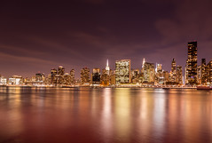 Warmth (Elyssa Drivas) Tags: newyork newyorkcity nyc night nightphotography sky skyline manhattan montauk gothamist gantryplaza gantryplazastatepark queens architecture water warm eastside eastriver river clouds colorful tone