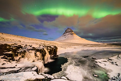 Kirkjufell mountain in Iceland (cozyjunior) Tags: 10stop bigstopper nisifilters nisi frozen wideangle auroraborealis astro nighttime longexposure ngc gourngefjord witcheshat landscape travelphotography nature green ocean stream ice water waterfall clouds samyang samyang14mm canon6mkii canon travel kirkjufell mountain northernlights snow aurora iceland