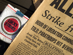 Lucky Strikes (kwphotos.com) Tags: lucky strike toasted cigarettes wrapper newspaper print vintage old wwii world war dday props items reenactment