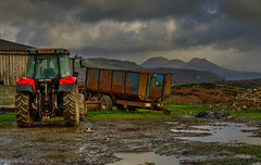 "I haven't seen that new film ""The Tractor"" yet, but I've seen the trailer. (alex.vangroningen) Tags: trailer tractor sky clouds mountains northwales mud water land outdoors shed"