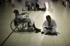 WHILE THE FATHER SLEEPS (N A Y E E M) Tags: father son wheelchair quran night lawn alharam holymosque makkah ksa saudiarabia candid availablelight light sooc raw unedited untouched umrah islam muslim pilgrims ihraam indonesian