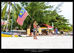 Langkawi Beach (Hagens_world) Tags: malaysia flag beach asia asien fahne flagge southeastasia strand südostasien bandera playa kampunglubukbuaya langkawi kedah canon canoneos5dmarkiii mys boy junge facebookpublic 2013malaysia